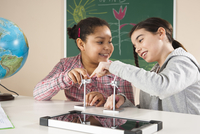 Girls Learning about Alternative Energy in Classroom, Baden-