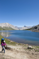 Hispanic woman hiking Skoki Trail with baby, Rocky Mountains