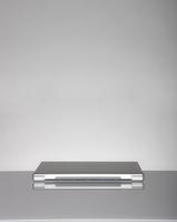 Laptop on a empty desk on grey background. 11030038368| 写真素材・ストックフォト・画像・イラスト素材|アマナイメージズ