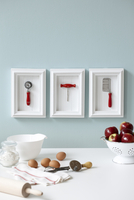 Framed Utensils over Kitchen Table with Apples, Eggs and Mixing Bowl
