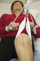 Senior Woman with Scar from Knee Replacement Surgery doing Physiotherapy Exercises in Hospital, Toronto, Ontario, Canada