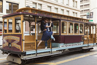 Couple Dancing on Cable Car, San Francisco, California, USA