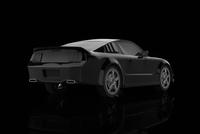 Illustration of sports car against a black background, studio shot