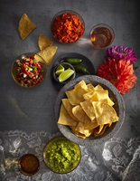 Variety of salsas, condiments and tortilla chips, Mexican Fiesta, studio shot
