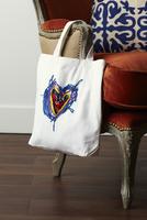 Handmade Tote Bag hanging on arm of chair, studio shot