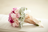 Close-up of bridal bouquet wrapped in ribbon, studio shot