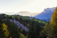 St Nikolaus Church and Village of Mittelberg in front of Mount Schlern at Sunrise in Autumn, Piedmond and South Tyrol, Italy
