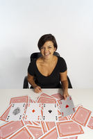 Mid-Adult Woman doing Magic Trick with Deck of Cards