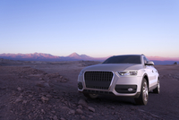 Illustration of luxury SUV in the desert at sunset, Atacama Desert, Chile