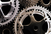 Illustration of close-up of various types of bicycle gears, conceptual represenatation, studio shot on black background