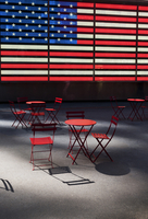 Electronic American Flag with empty tables and chairs, Times Square, New York City, New York, USA
