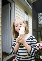 Portrait of a 6 year-old girl eating an ice cream cone, outdoors, Moncton, New Brunswick, Canada
