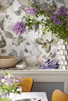 Dining Room with Table Setting and Bowls, Napkins and Purple Flowers