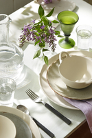 Close-up of Table Setting with Flowers in Dining Room