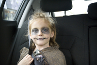Girl in Car Dressed up for Halloween as Zombie Viking Shieldmaiden, Toronto, Ontario, Canada