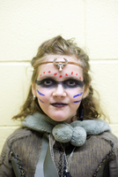 8 year-old girl dressed up at school for Halloween as a Viking Shield Maiden, Toronto, Ontario, Canada