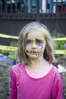 Girl wearing Zombie Make-up in front of Caution Tape for Halloween, Toronto, Ontario, Canada