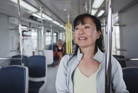Close-up of Woman Traveling on Subway, Canada Line, Rapid Transit System, Vancouver, British Columbia, Canada