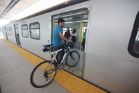 Man Carrying Bicycle on Board Subway Train, Canada Line, Rapid Transit System, Vancouver, British Columbia, Canada
