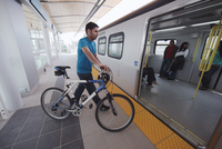 Man With Bicycle Getting on Subway, Vancouver, British Columbia, Canada