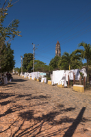 Street vendors on cobblestone street, Torre de Manacas-Iznaga in background, Valle de los Ingenios, Trinidad, Cuba, Caribbean