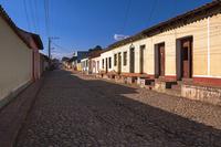 Buildings on cobblestone street, Trinidad, Cuba, West Indies, Caribbean