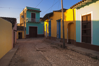 Colorful buildings on cobblestone street, Trinidad, Cuba, West Indies, Caribbean