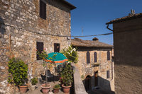 View of building with balcony garden, San Gimignano, Province of Siena, Tuscany, Italy