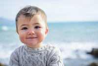 Baby Boy in Sweater by Sea in Winter, Italy