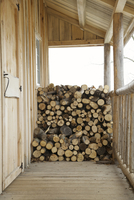 Firewood logs stacked on porch in winter, St Catharines, Ontario, Canada