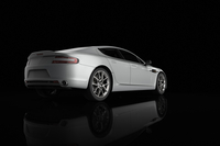 Illustration of white, luxury sports car, studio shot on black background