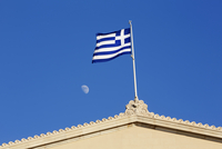 Close-up of Greek Flag in front of moon on top of the Greek Parliament Building (Old Royal Palace), Athens, Greece