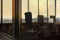 Illustration of Empty Boardroom in Office Building, with view of New York City through windows, New York, USA