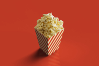 Digital Illustration of Box of Popcorn on Red Background