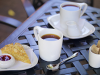Two White Mugs of Tea on Patio Table with Scone and Jam, Dundas, Ontario, Canada