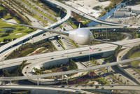 Illustration of a drone plane surveilling traffic over the freeway, Miami, Florida, USA
