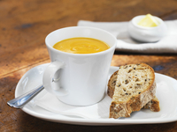 Butternut Squash Soup in Mug with Bread and Butter, Studio Shot