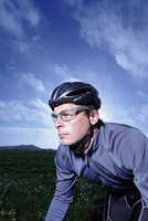Close-up portrait of male triathelete on bicycle training and cycling near Point Reyes, California, USA