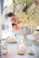 Candle and Floral Centrepiece at Wedding Reception