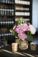 Hydrangeas in Vase with Candles at Wedding Reception
