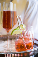 Close-up of Pink Champagne and Cocktail on Serving Tray