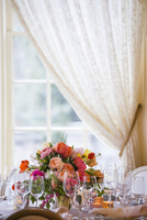 Table Setting with Floral Centerpiece by Window