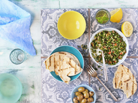 Overhead View of Middle Eastern Meal with Pita Bread, Tabouleh and Olives 11030049240| 写真素材・ストックフォト・画像・イラスト素材|アマナイメージズ