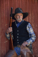 Portait of Cowboy with Rifle, Shell, Wyoming, USA