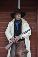 Portrait of Cowboy with Rifle, Shell, Wyoming, USA