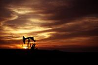 Pump Jack in Oilfield at Sunset, Saskatchewan, Canada
