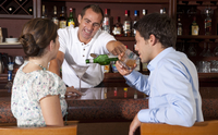 Couple having Drinks at Bar, Reef Playacar Resort and Spa, Playa del Carmen, Mexico