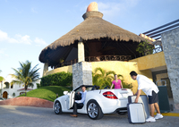 Porter Loading Luggage into Car, Reef Playacar Resort and Spa, Playa del Carmen, Mexico