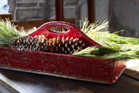 Pine Cones and Pine Needles in Wooden Trug