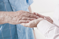 Close-up of Caregiver holding Patient's Hand